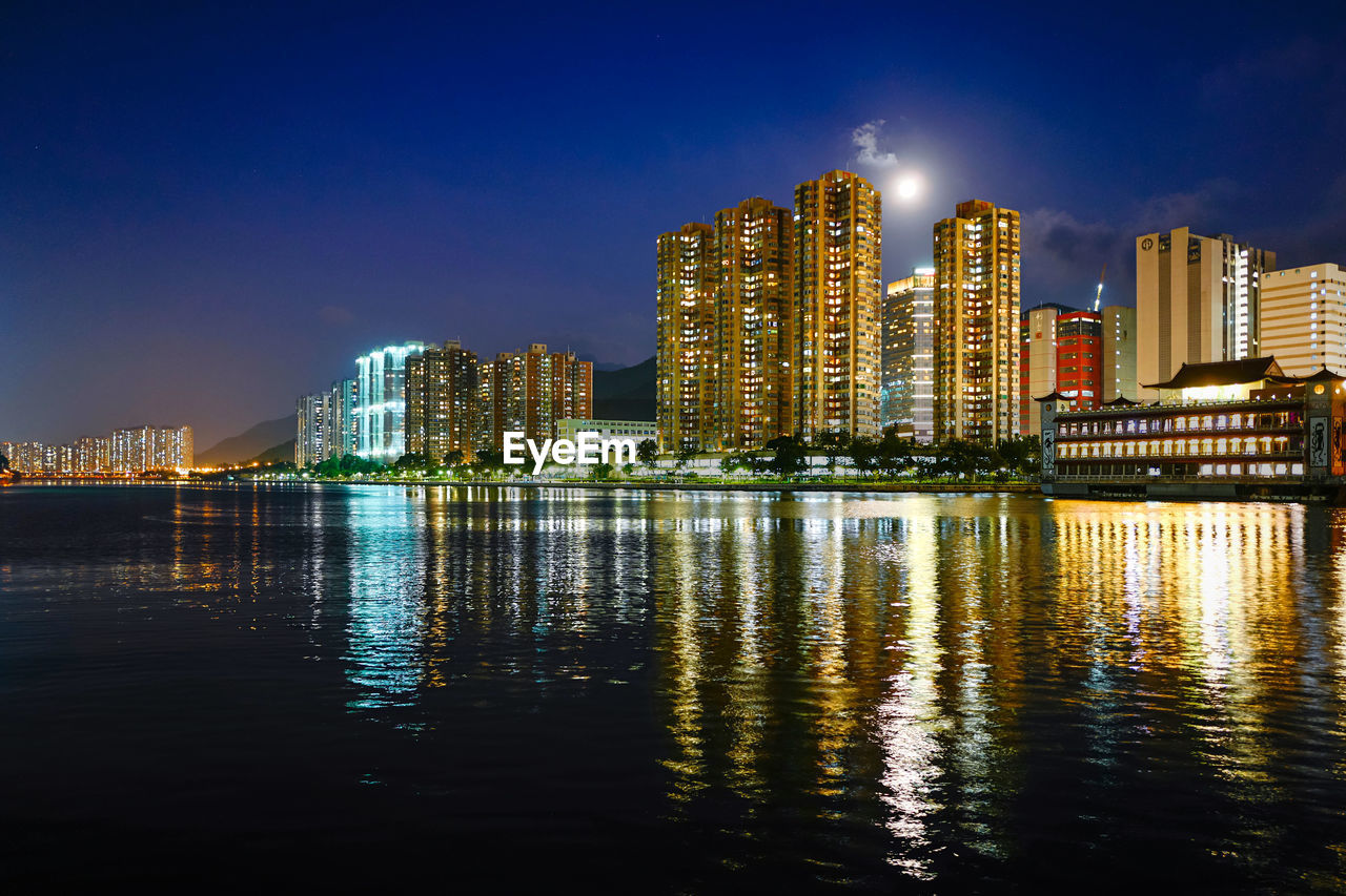 building exterior, architecture, water, built structure, waterfront, sky, reflection, city, illuminated, building, night, urban skyline, nature, office building exterior, no people, landscape, cityscape, skyscraper, river, modern, tall - high, outdoors, financial district