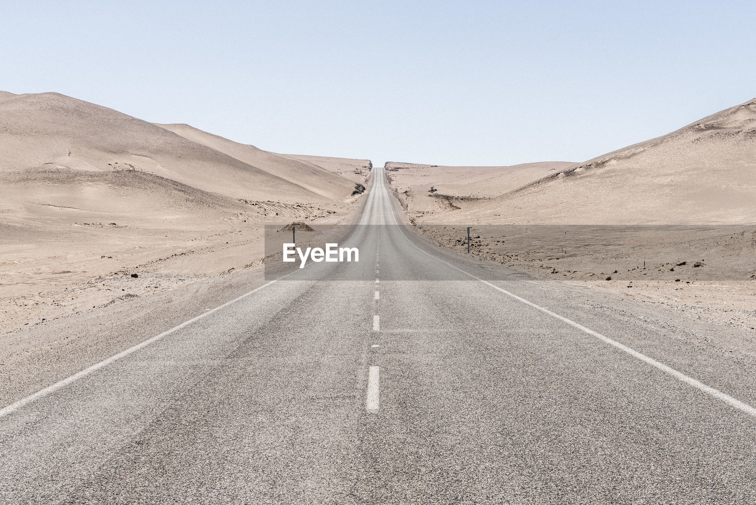 View of road along desert against sky
