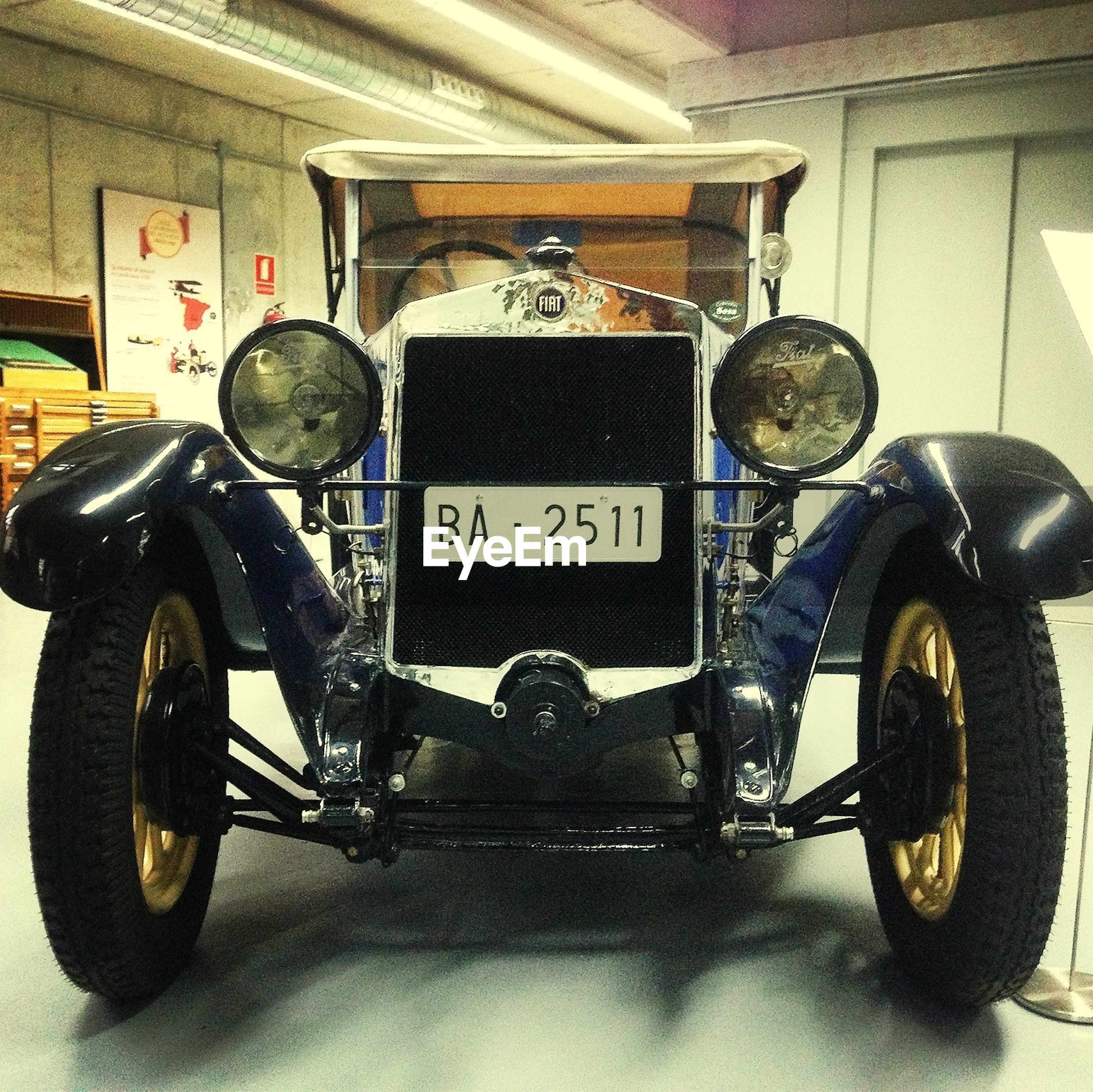 indoors, transportation, old-fashioned, mode of transport, retro styled, land vehicle, vintage, communication, text, stationary, technology, antique, western script, metal, no people, car, old, vintage car, close-up, headlight