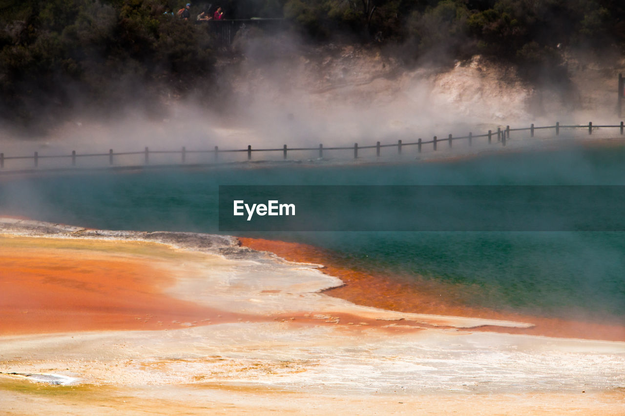 smoke - physical structure, heat - temperature, water, steam, power in nature, nature, hot spring, beauty in nature, scenics - nature, no people, outdoors, motion, fog, geyser, orange color, day, environment, geology, non-urban scene