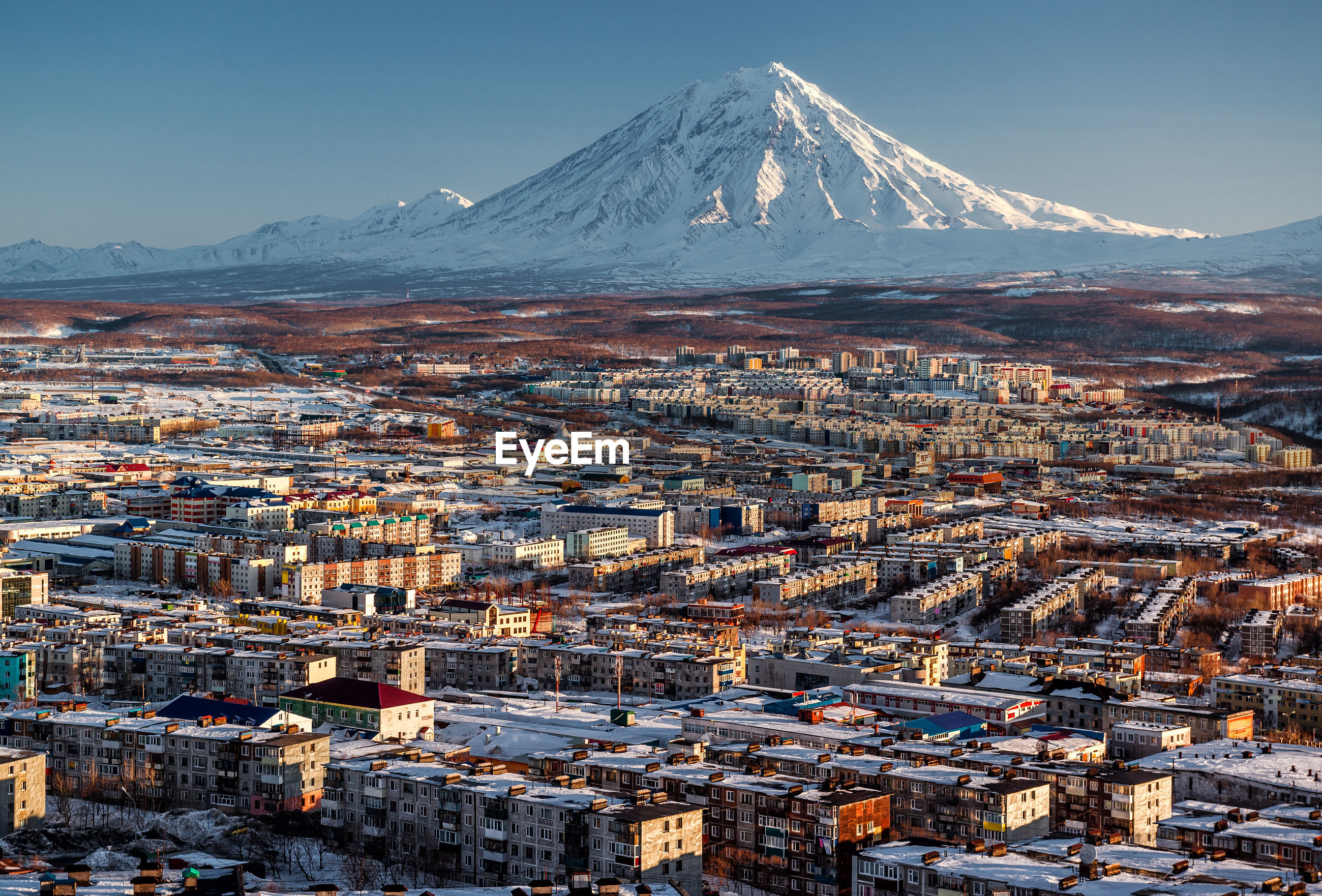 View of townscape and mountain during winter