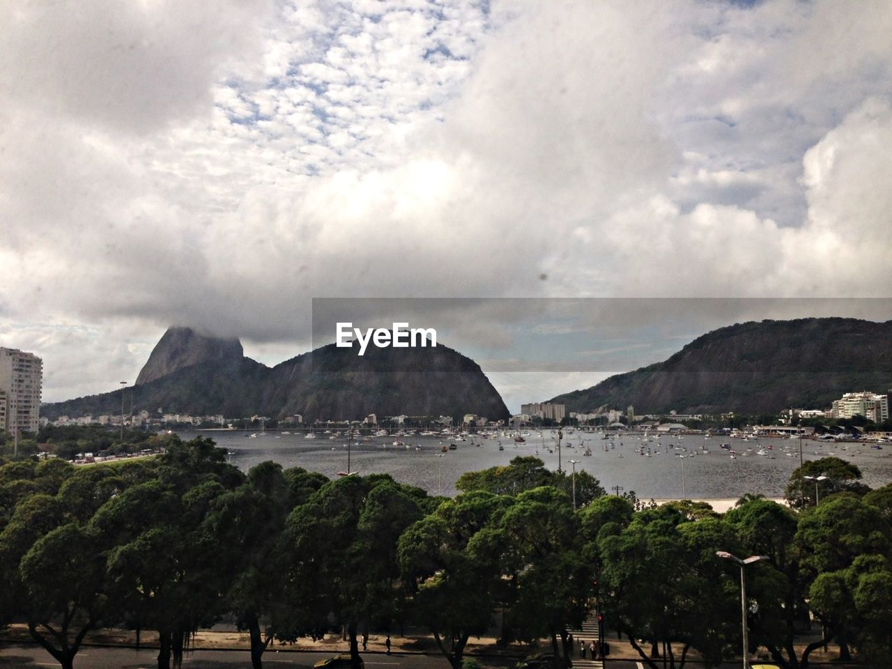 sky, mountain, water, nature, cloud - sky, beauty in nature, outdoors, sea, day, no people, architecture, city, tree