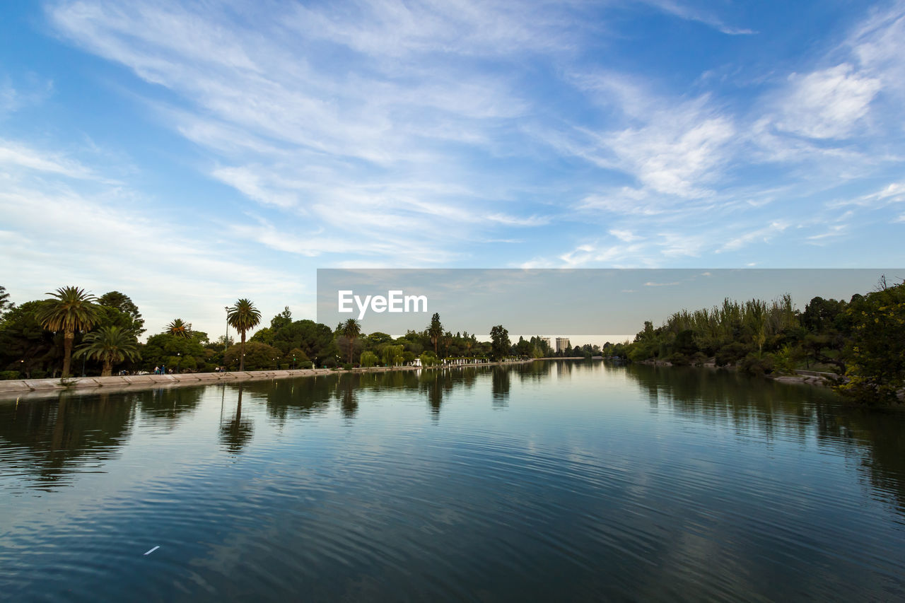 sky, water, tree, cloud - sky, reflection, scenics - nature, tranquil scene, plant, tranquility, beauty in nature, nature, no people, waterfront, lake, idyllic, non-urban scene, day, outdoors