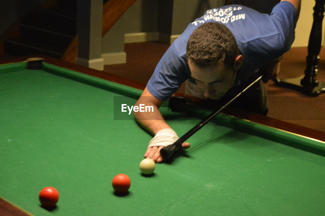 Young man playing snooker