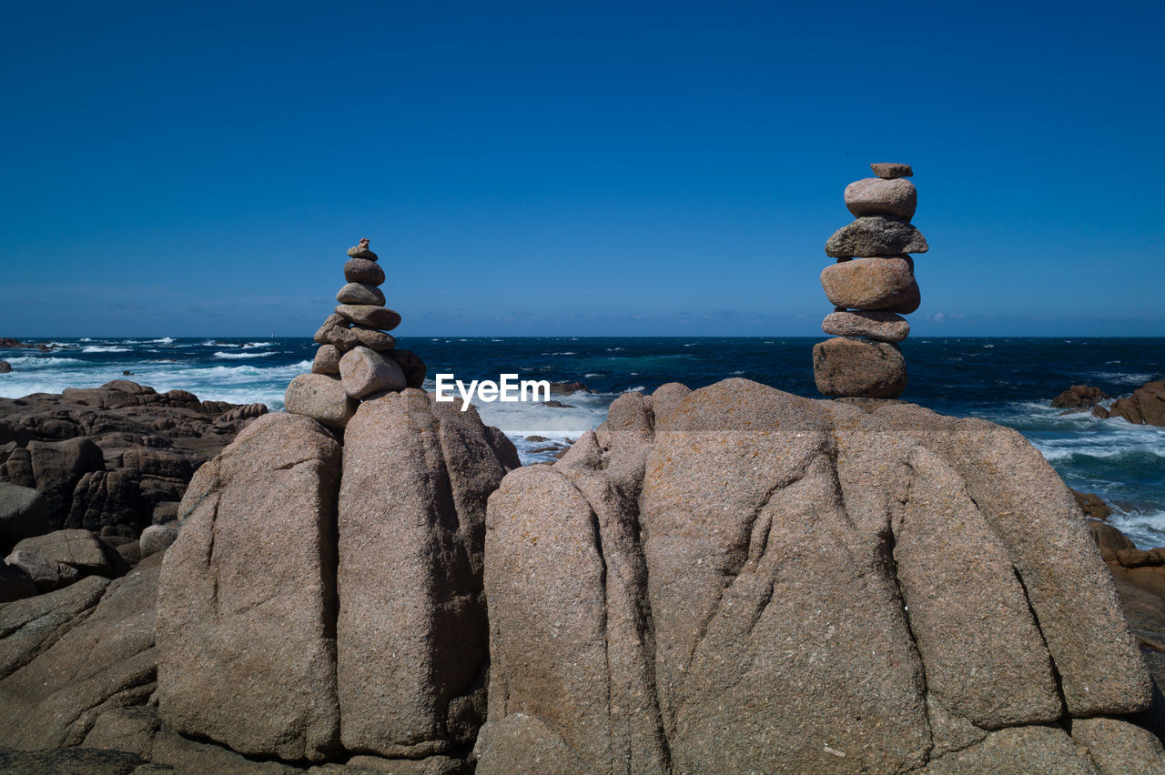 sea, rock - object, horizon over water, water, nature, beauty in nature, tranquility, blue, outdoors, no people, clear sky, day, scenics, beach, sky