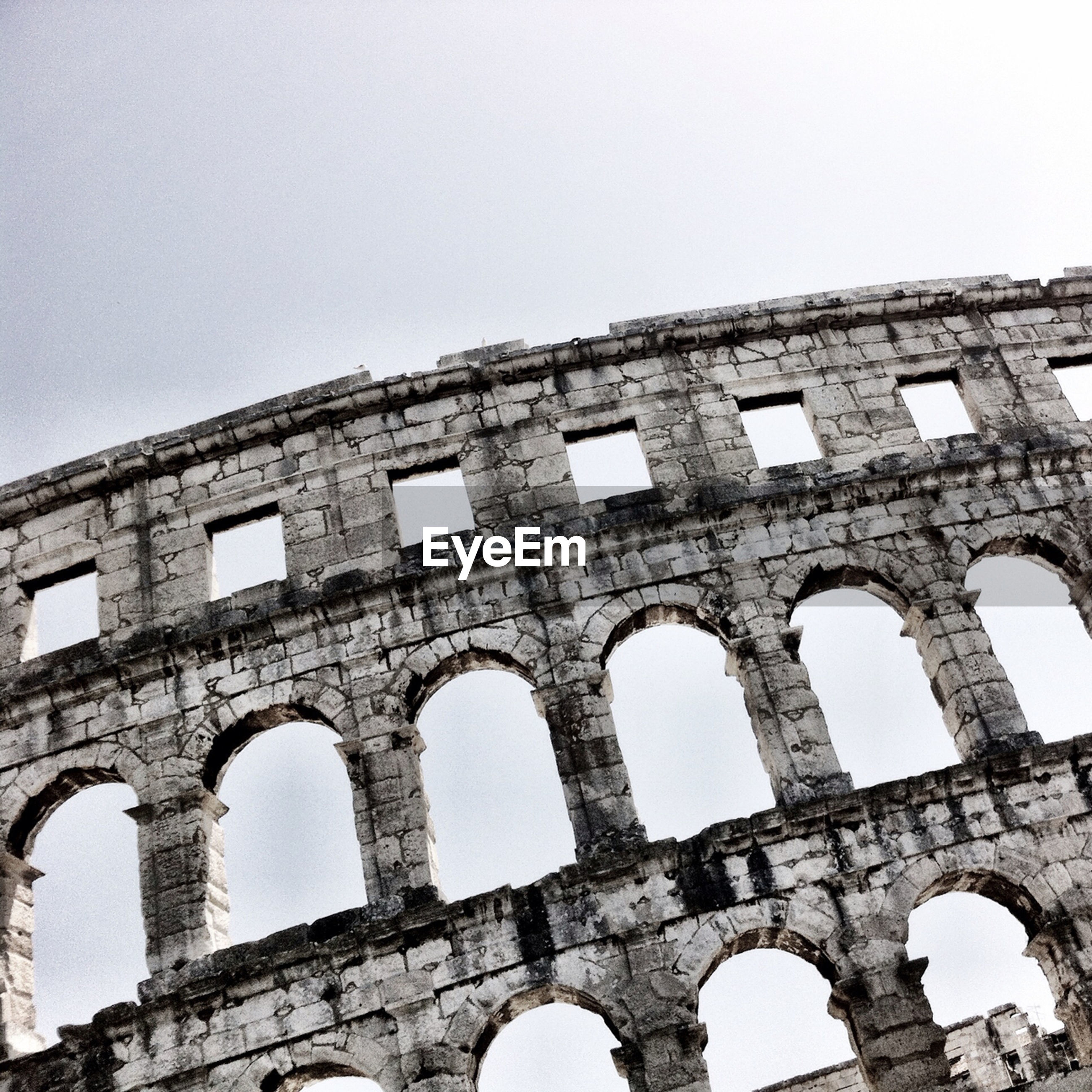 architecture, built structure, arch, history, clear sky, old ruin, building exterior, old, low angle view, ancient, the past, abandoned, damaged, copy space, weathered, coliseum, obsolete, ancient civilization, culture, ruined