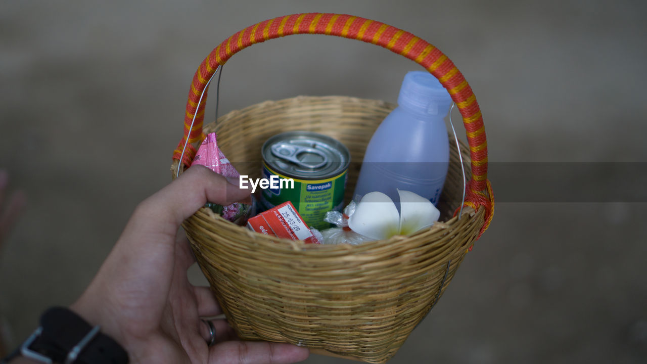 human hand, basket, hand, container, holding, one person, human body part, real people, wicker, lifestyles, body part, close-up, food and drink, personal perspective, focus on foreground, craft, unrecognizable person, leisure activity, art and craft, finger, human limb