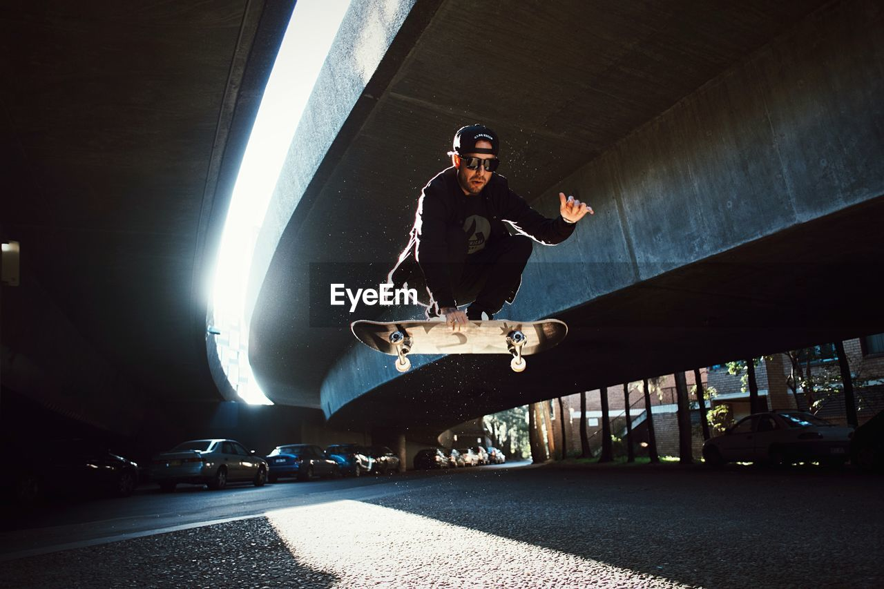 Low Angle View Of Man Jumping On Skateboard