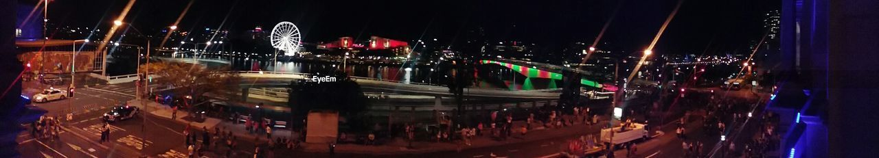 night, illuminated, arts culture and entertainment, panoramic, nightlife, outdoors, amusement park ride, large group of people, multi colored, city, architecture, ice rink, people