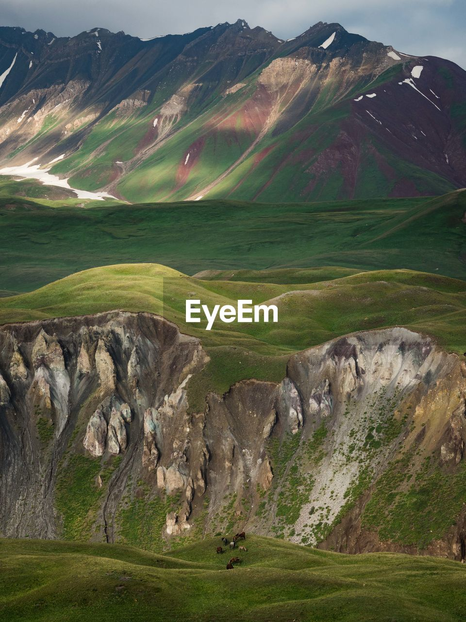 Scenic View Of Green Mountains