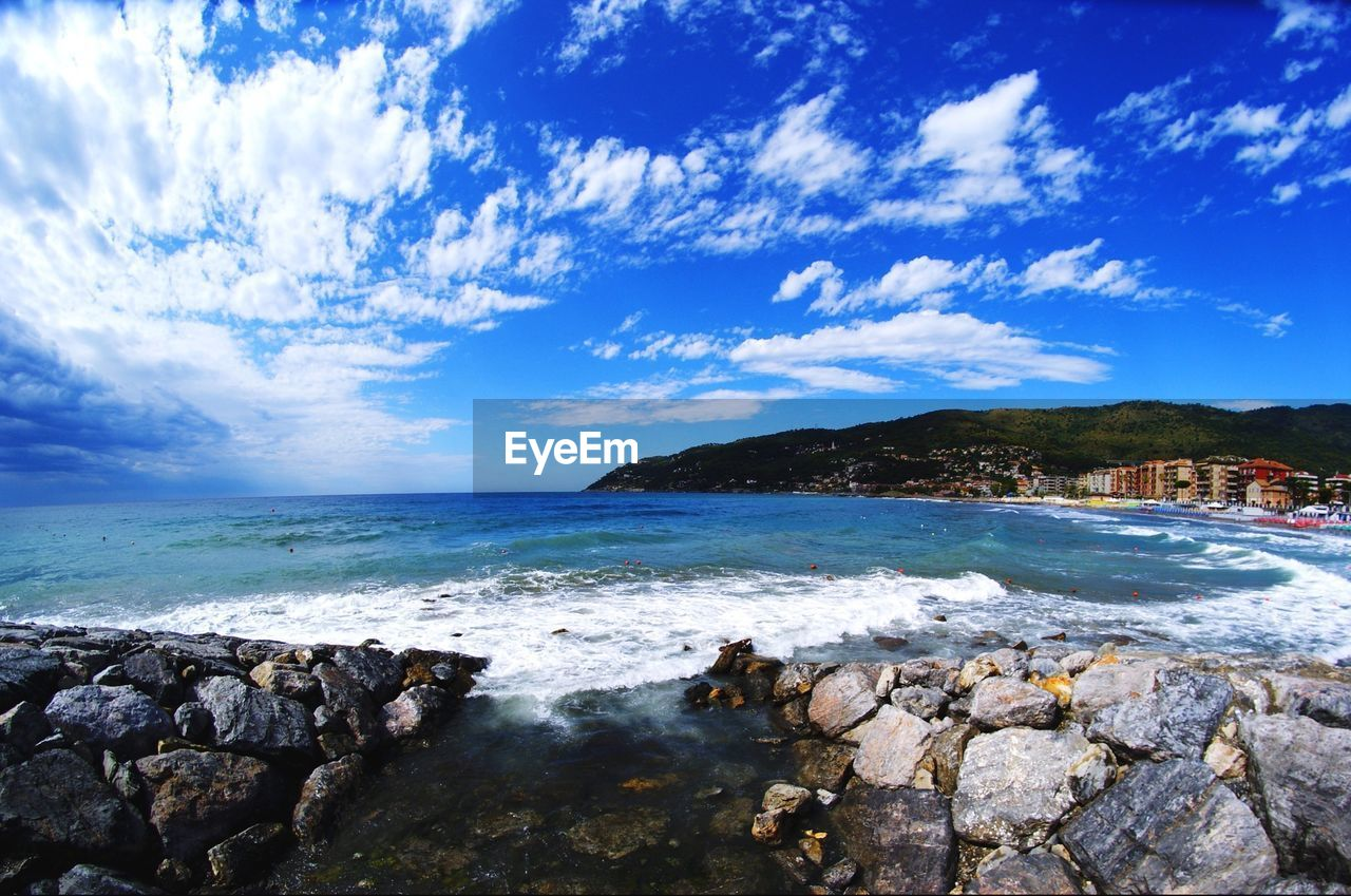 Scenic view sea against cloudy sky