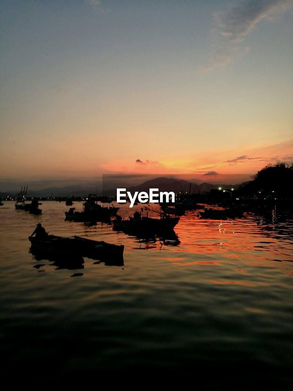 water, sunset, sky, beauty in nature, nautical vessel, orange color, reflection, scenics - nature, silhouette, tranquil scene, tranquility, transportation, waterfront, mode of transportation, nature, lake, no people, idyllic, outdoors, floating on water