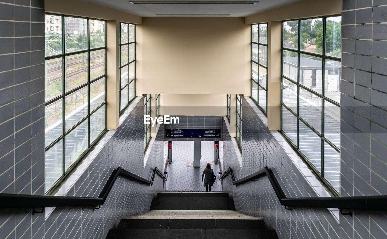 High angle view of woman on staircase at railroad station