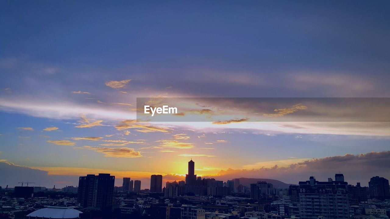 architecture, building exterior, cityscape, sunset, built structure, city, skyscraper, sky, cloud - sky, urban skyline, no people, residential building, modern, outdoors, nature, day
