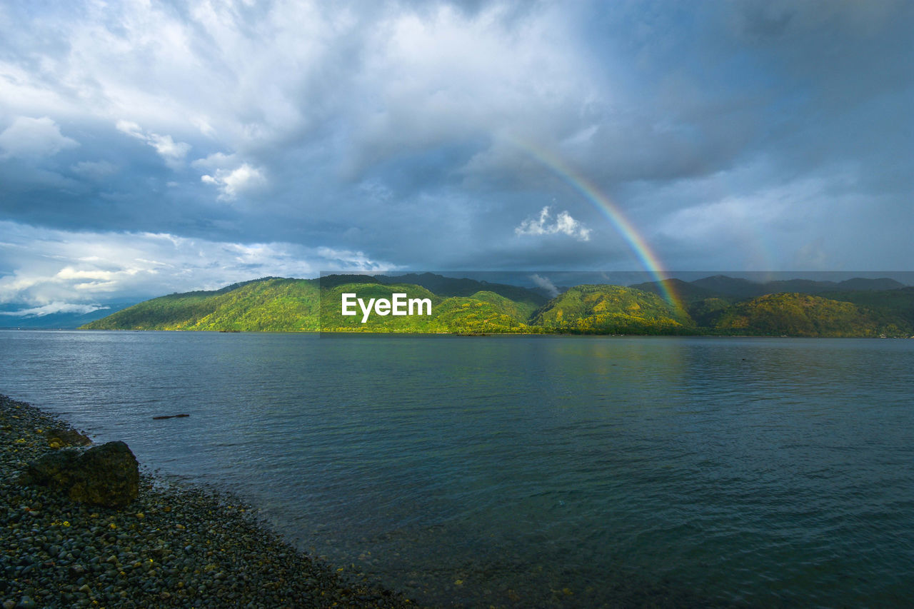 water, cloud - sky, sky, scenics - nature, beauty in nature, rainbow, tranquil scene, tranquility, idyllic, sea, no people, non-urban scene, nature, day, waterfront, double rainbow, outdoors, overcast