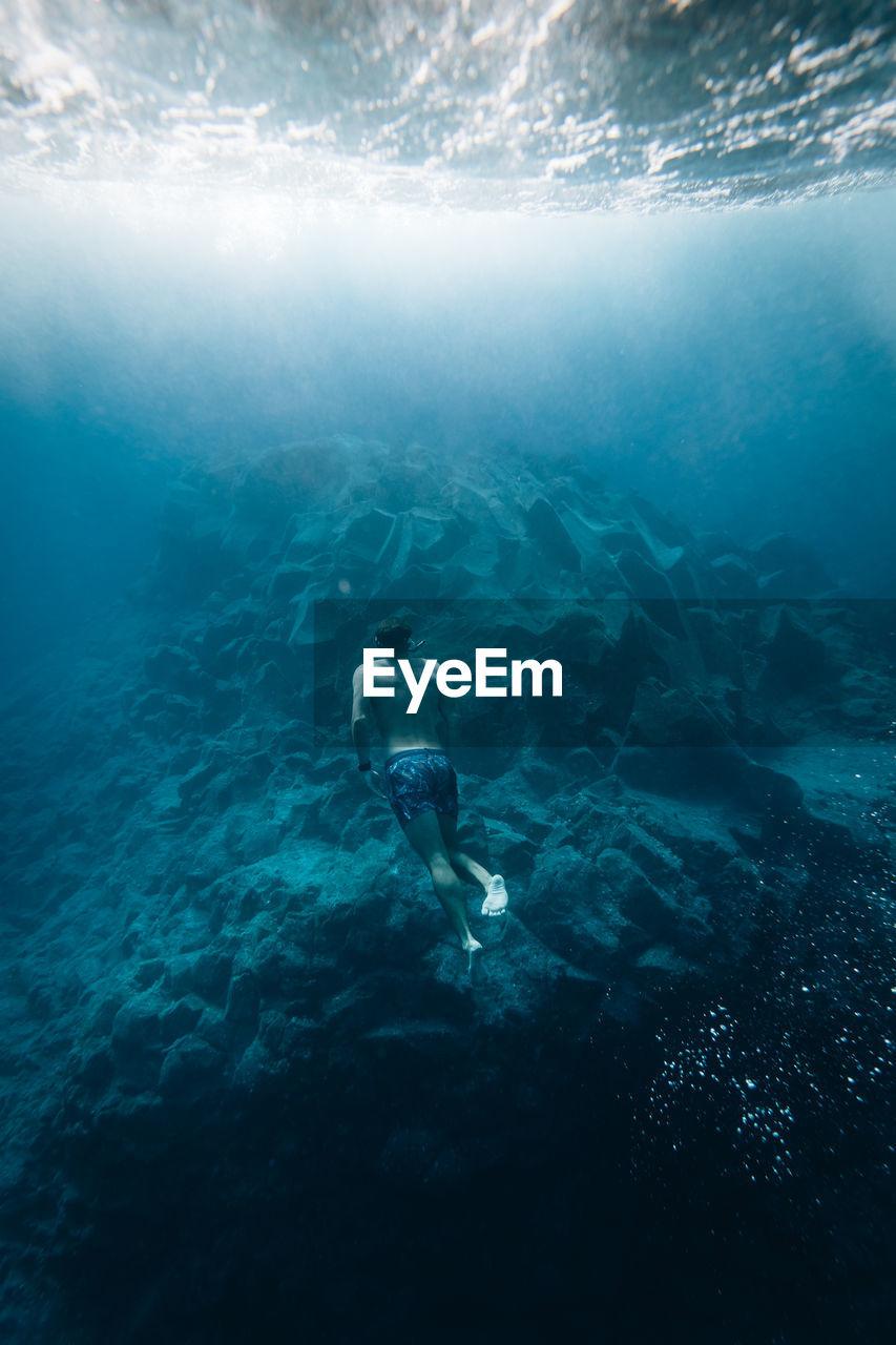 Rear View Full Length Of Man Swimming In Sea