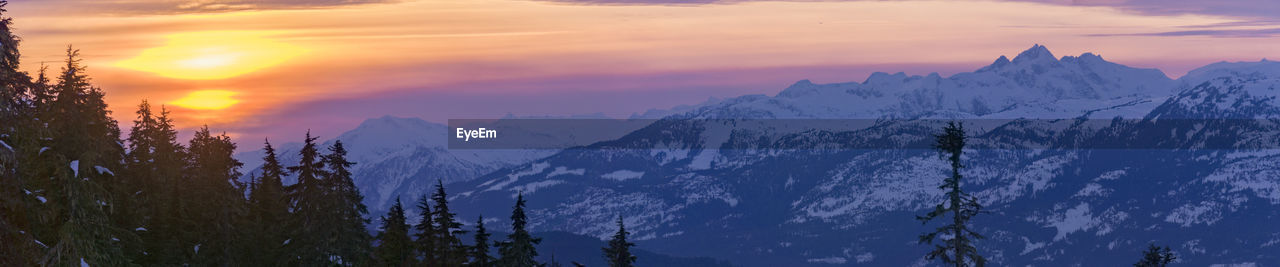 sunset, beauty in nature, sky, mountain, scenics - nature, cloud - sky, tranquility, tranquil scene, idyllic, nature, tree, plant, mountain range, no people, snow, orange color, cold temperature, environment, non-urban scene, winter, outdoors, snowcapped mountain, mountain peak