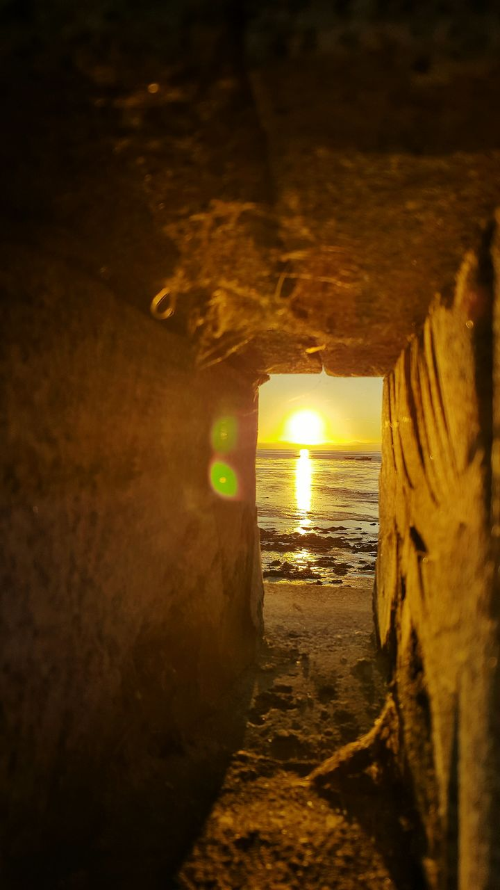 tunnel, sand, illuminated, beach, the way forward, cave, no people, sea, water, horizon over water, sunset, indoors, nature, night, sky