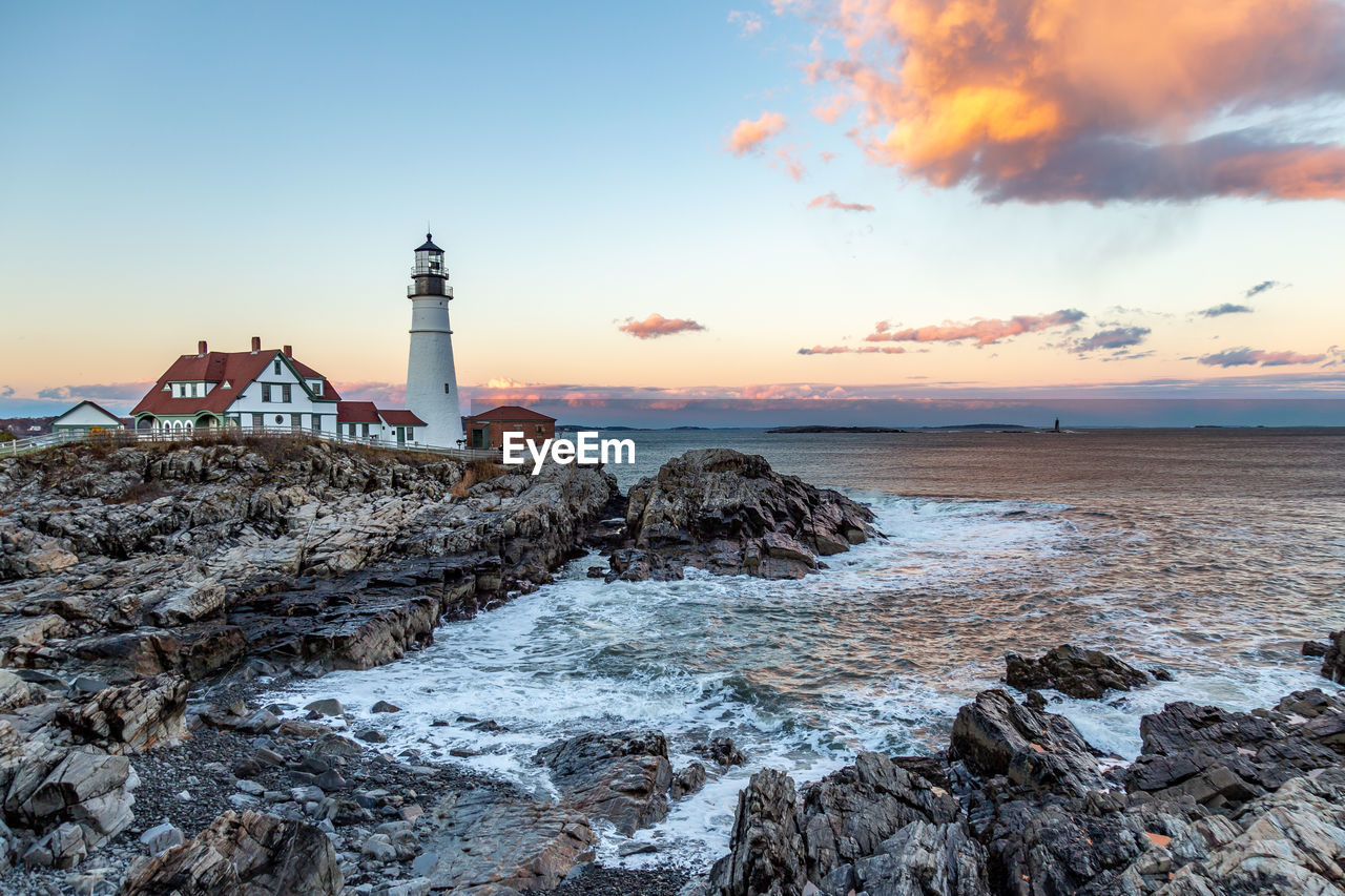 sky, water, sea, sunset, built structure, architecture, building exterior, rock, beauty in nature, tower, scenics - nature, cloud - sky, rock - object, nature, guidance, solid, beach, lighthouse, building, no people, horizon over water, outdoors