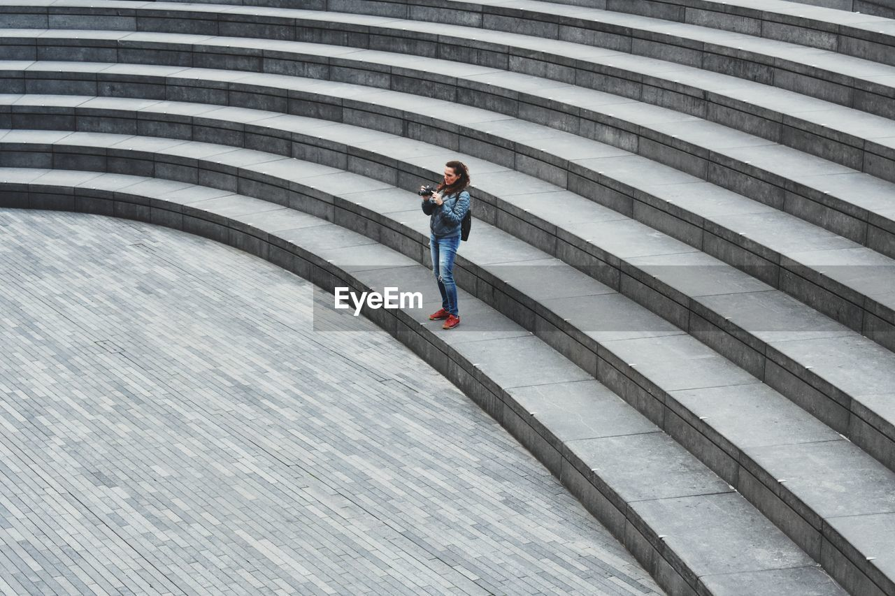 High Angle View Of Woman Standing On Steps
