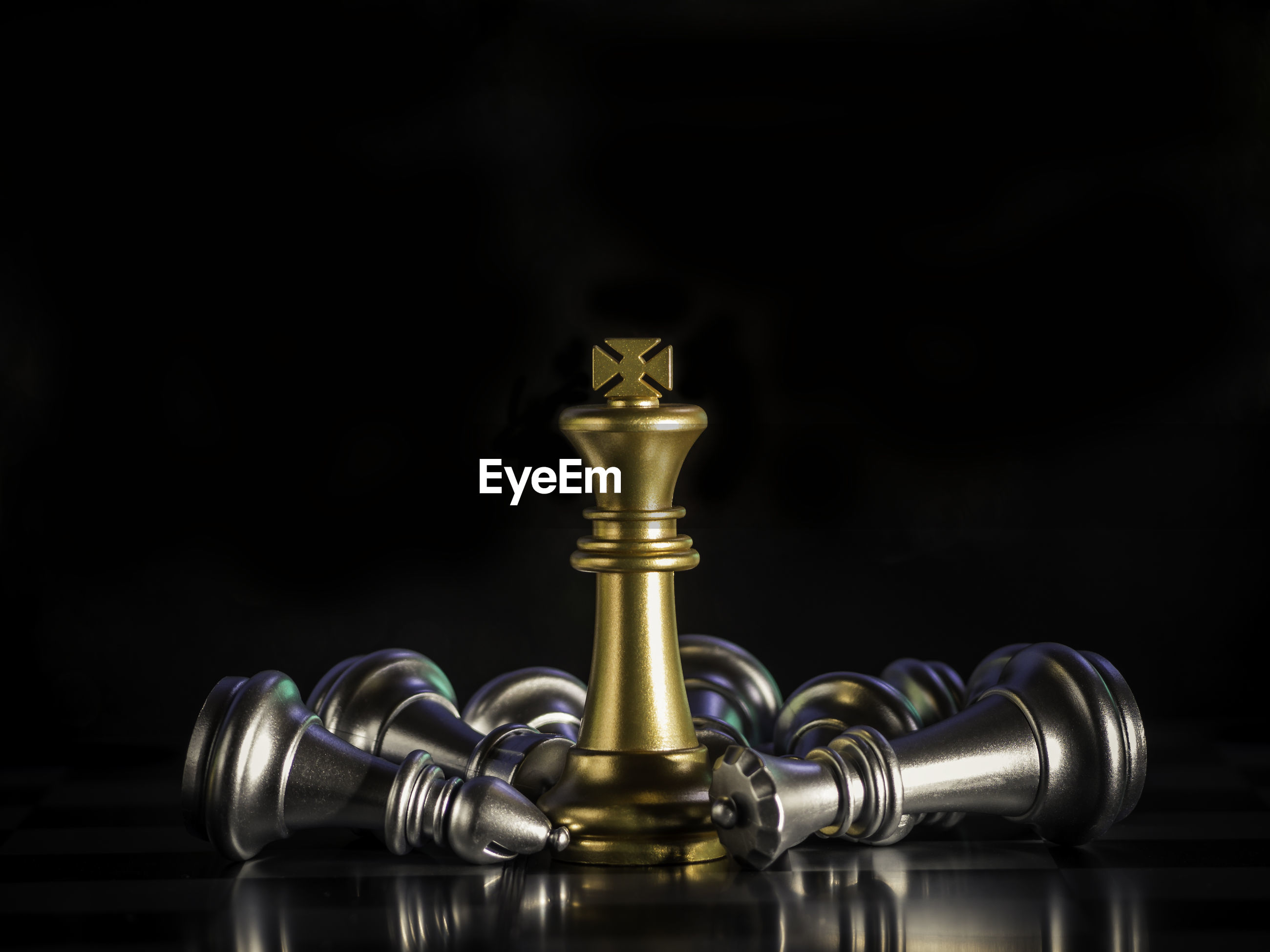 CLOSE-UP OF CHESS PIECES ON BLACK BACKGROUND