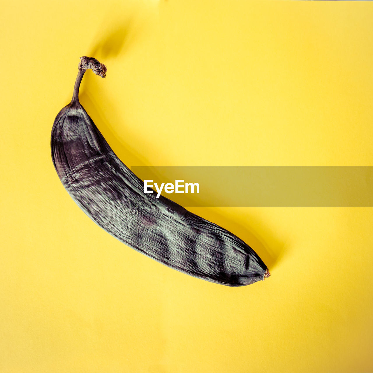 Close-Up Of A Rotten Banana On Yellow Background