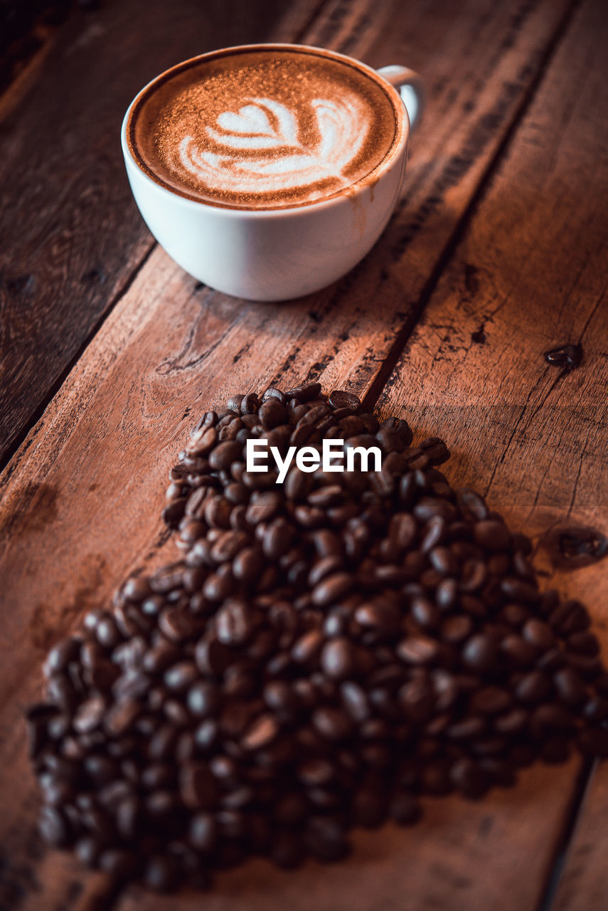 food and drink, coffee, coffee - drink, still life, coffee cup, mug, refreshment, drink, cup, freshness, food, cappuccino, frothy drink, roasted coffee bean, indoors, table, brown, high angle view, no people, froth art, hot drink, latte, caffeine, crockery, non-alcoholic beverage, coffee shop