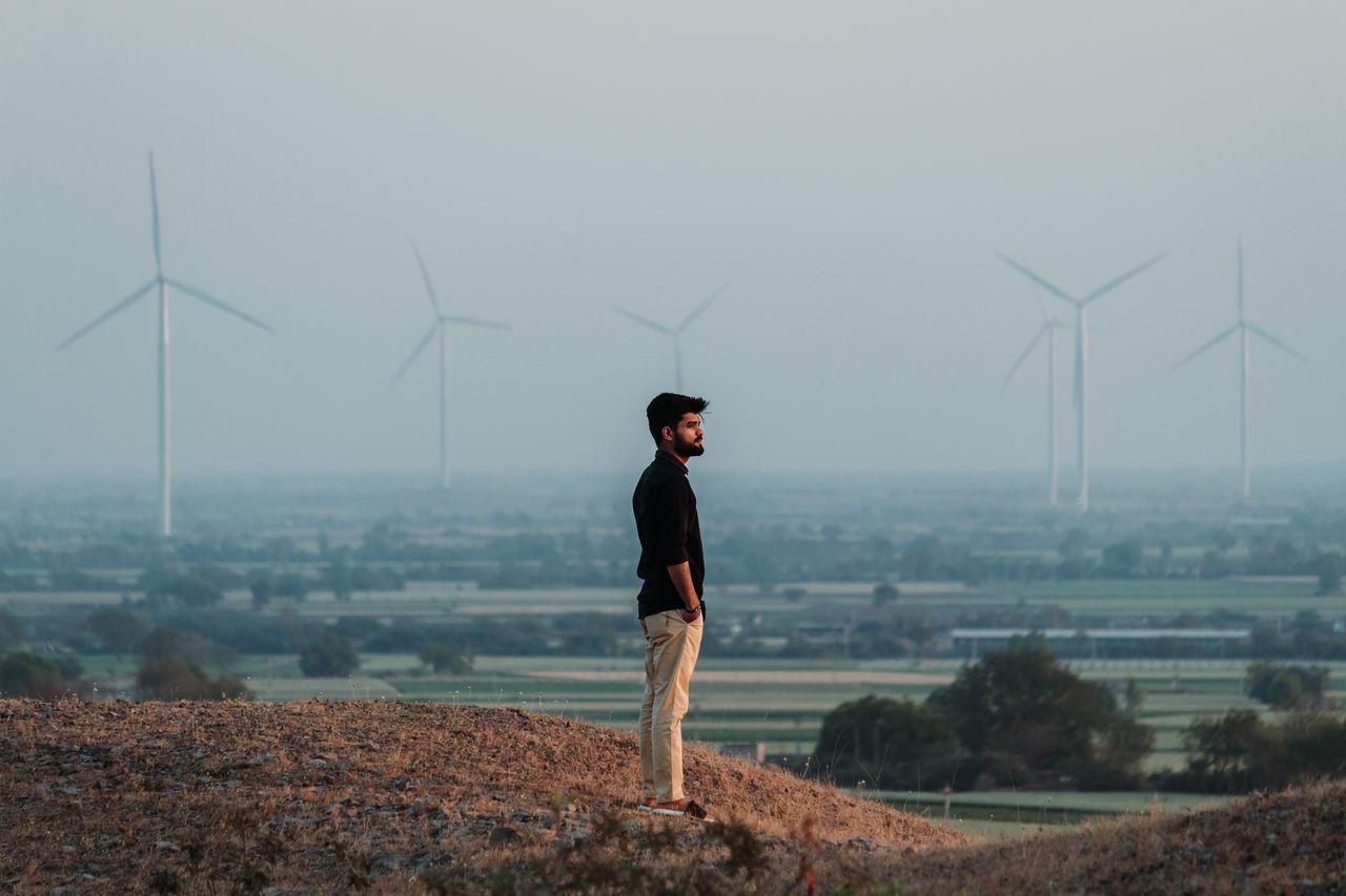 Full length of man standing on cliff against sky