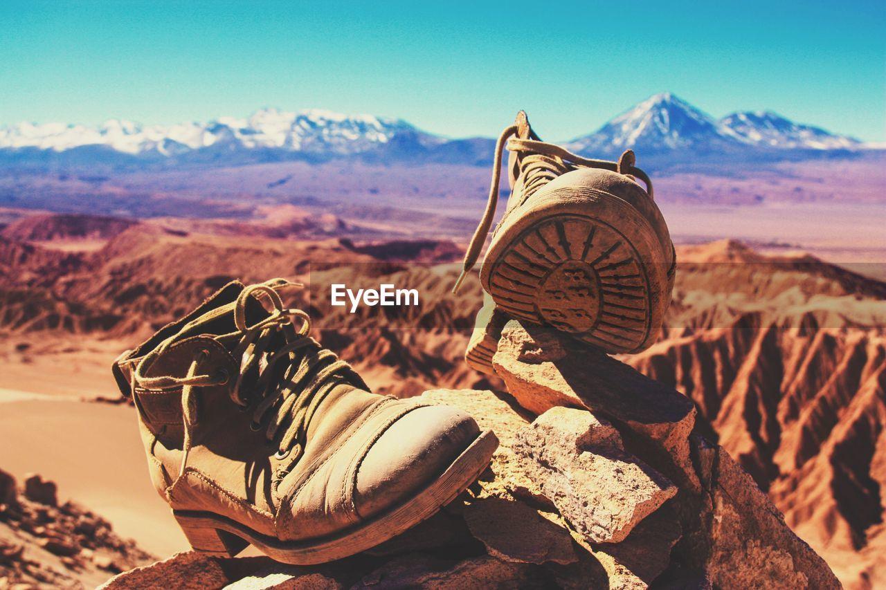 Close-Up Of Boots On Rock At Atacama Desert