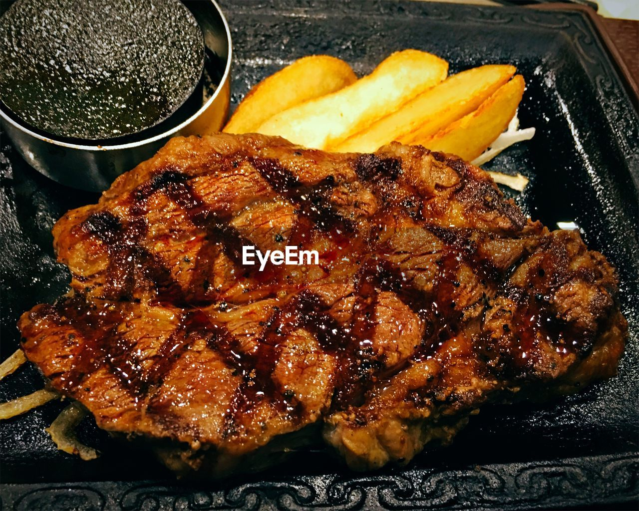 Close-up of grilled steak served in tray