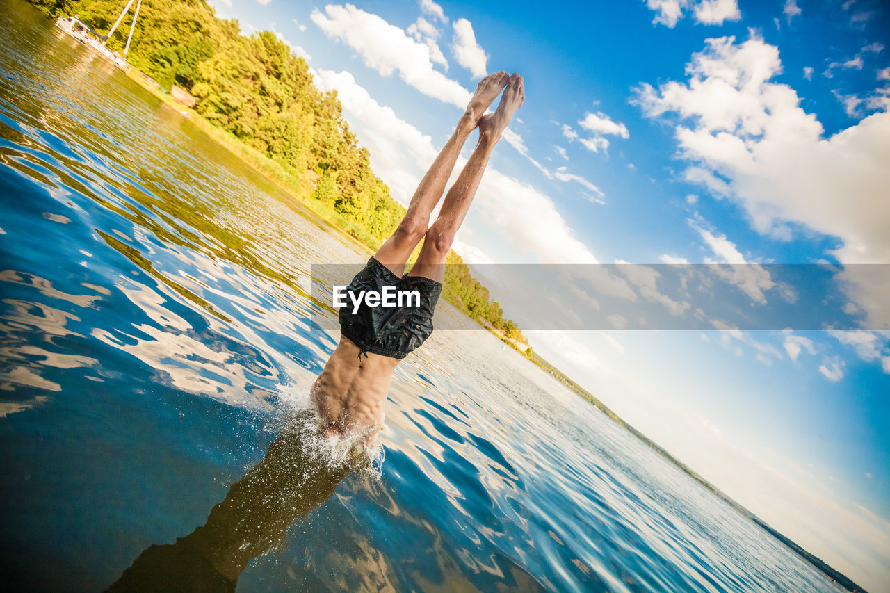 Man In Handstand In Water