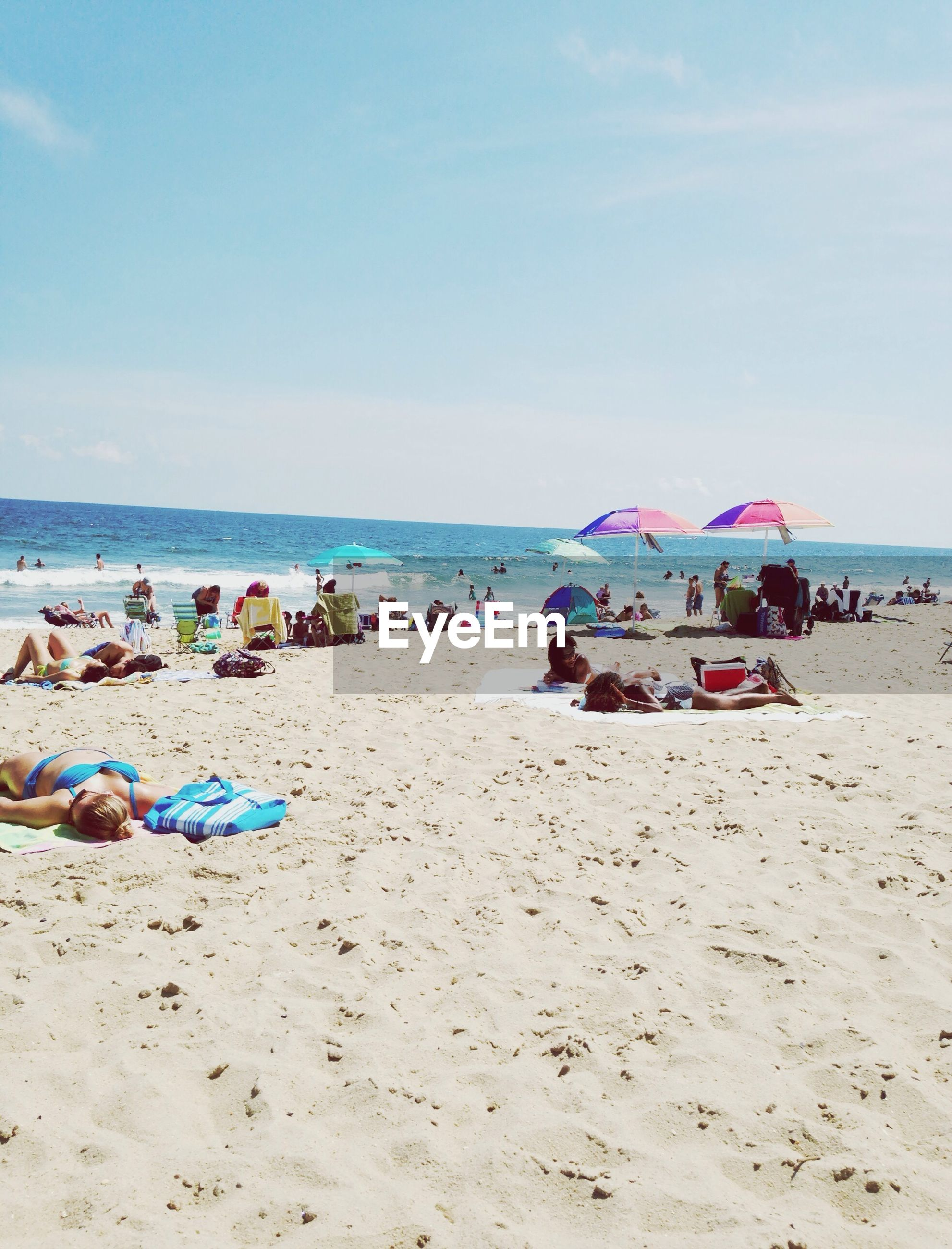 beach, sea, sand, shore, water, horizon over water, vacations, large group of people, sky, beach umbrella, summer, leisure activity, tranquility, scenics, relaxation, tranquil scene, nautical vessel, parasol, nature