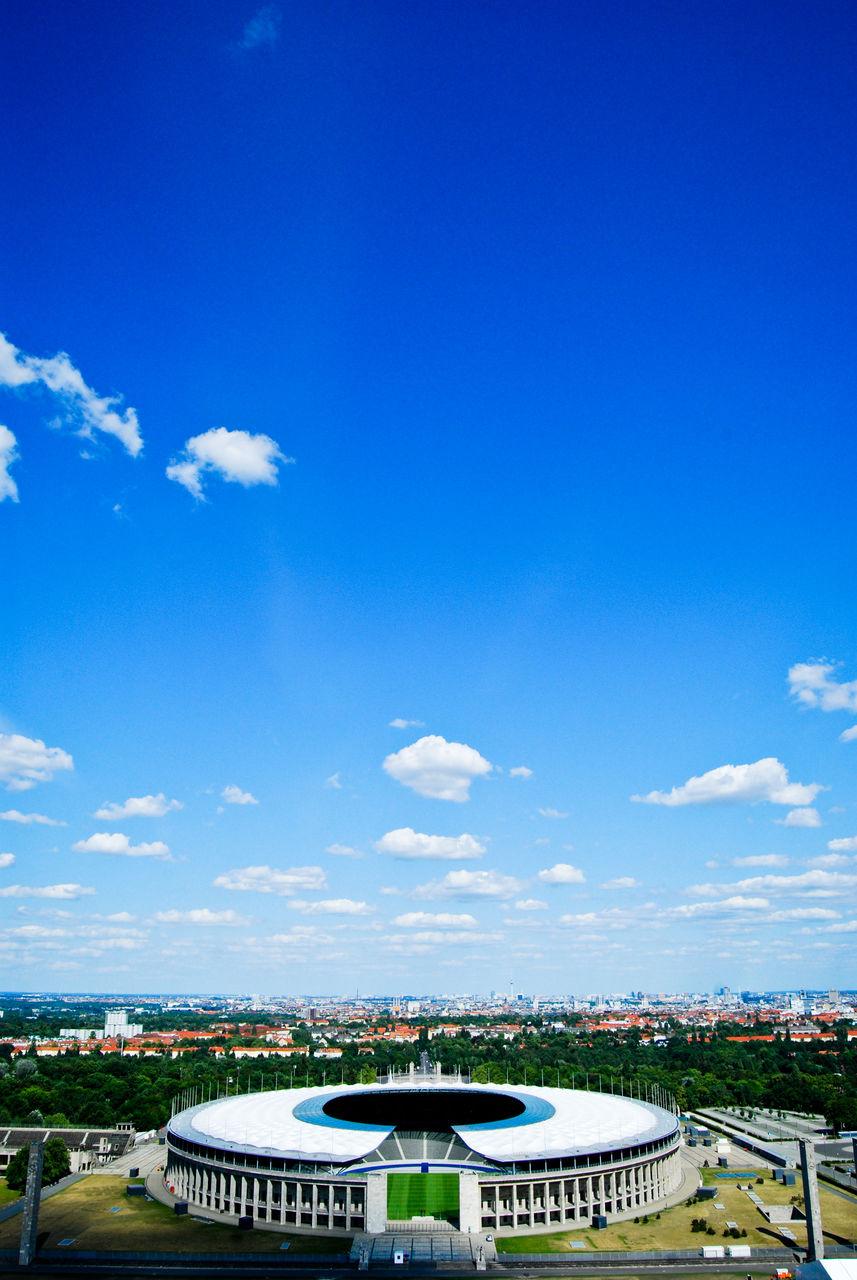 blue, architecture, cloud - sky, sky, stadium, day, built structure, no people, building exterior, outdoors, cityscape, city