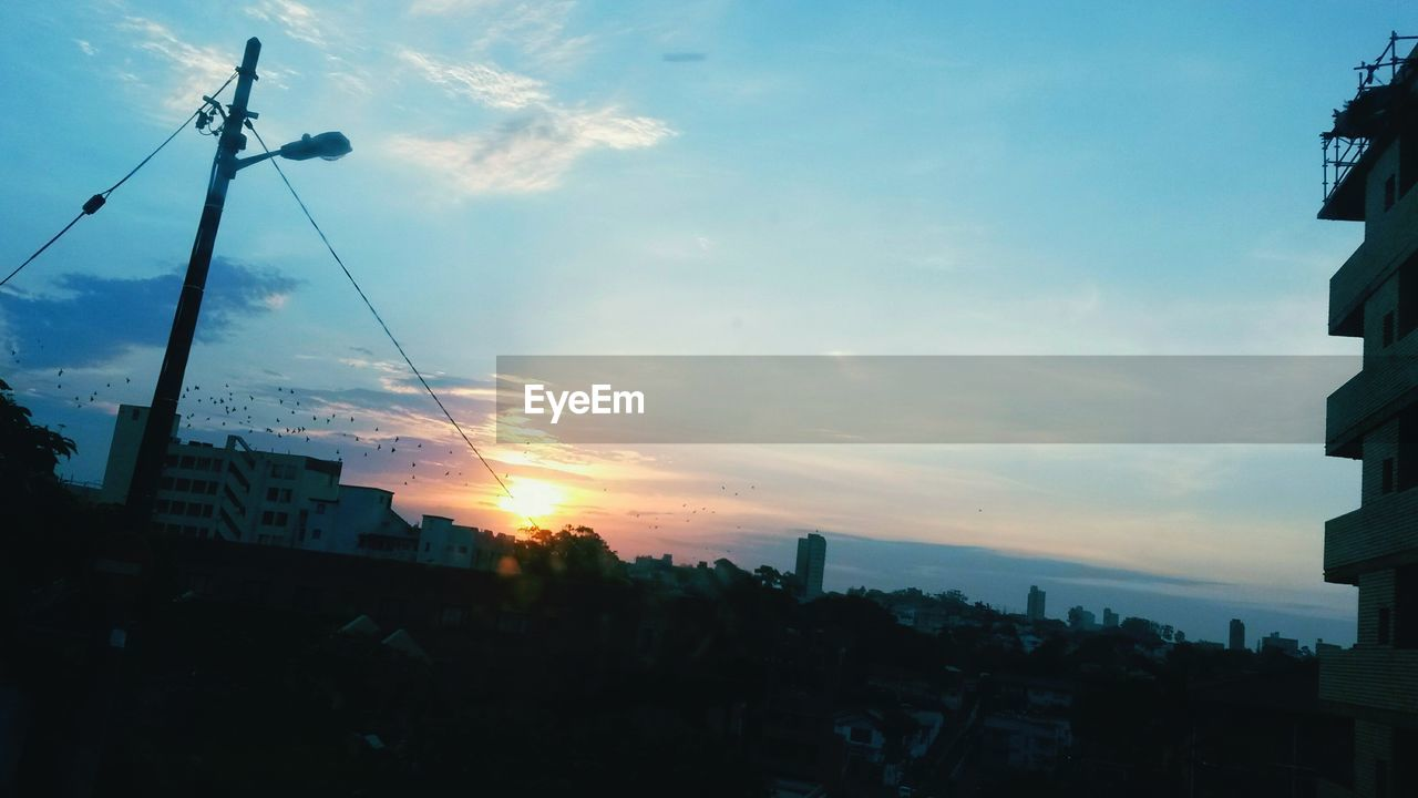 sunset, sky, cloud - sky, sun, silhouette, architecture, building exterior, city, outdoors, built structure, no people, sea, nature, cityscape, beauty in nature, day