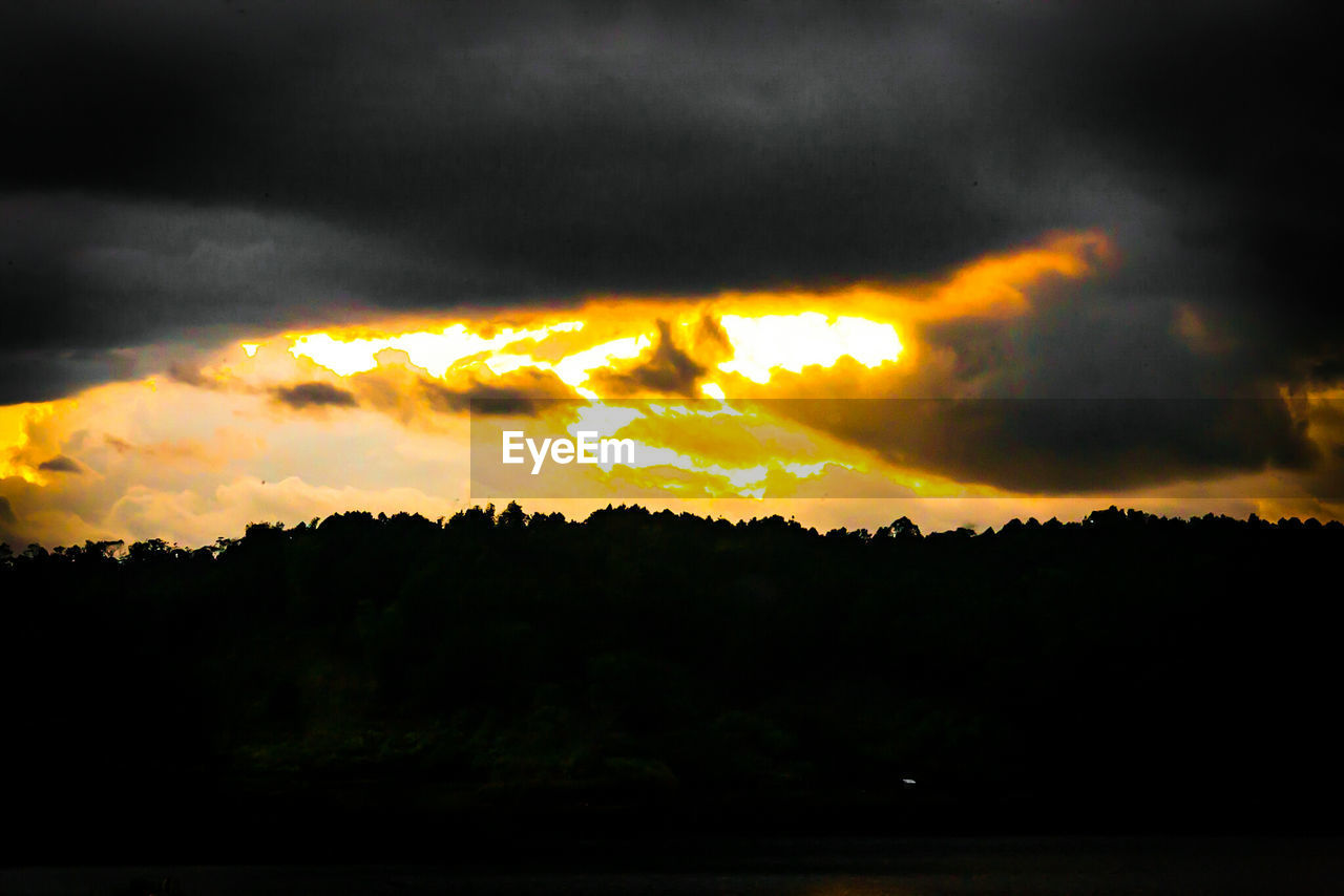 silhouette, sunset, sky, cloud - sky, beauty in nature, scenics, nature, dramatic sky, tranquility, tranquil scene, no people, outdoors, storm cloud, landscape, tree, night