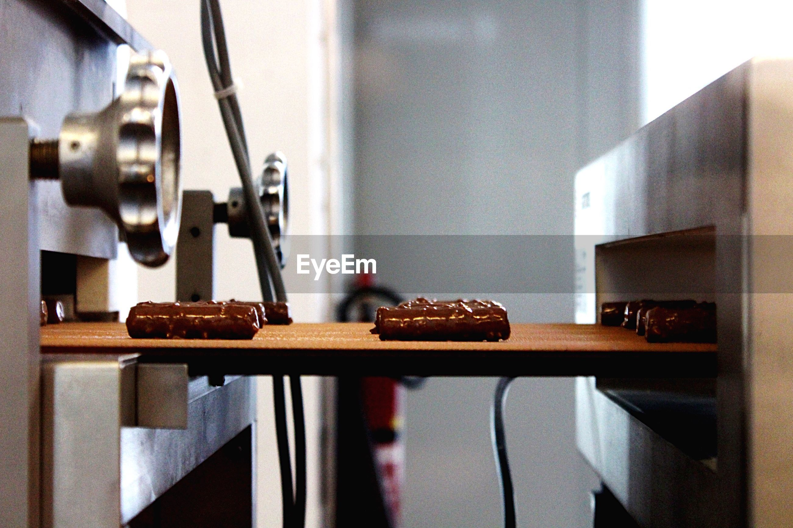 Chocolates on conveyor belt in factory