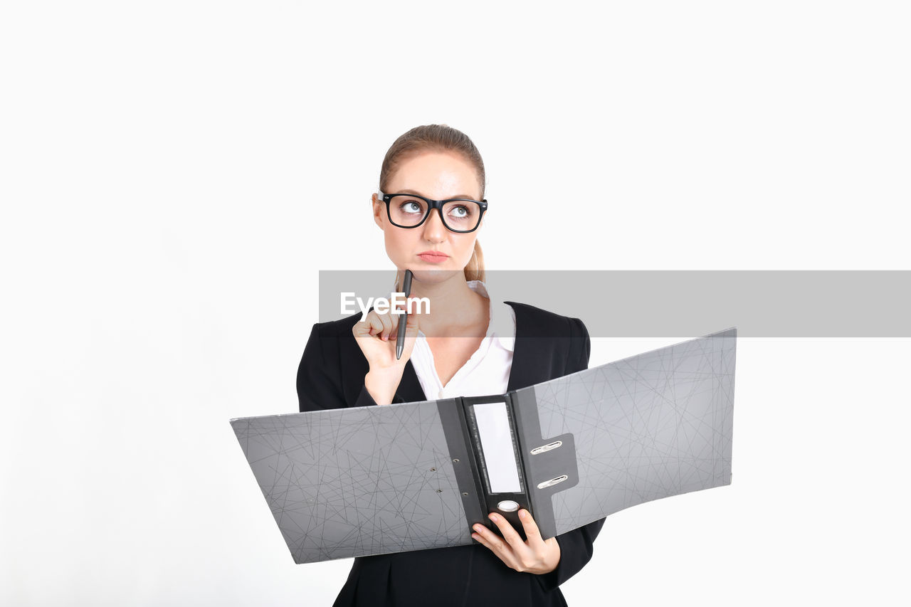 front view, white background, studio shot, glasses, one person, eyeglasses, business person, cut out, young adult, looking at camera, copy space, businesswoman, indoors, waist up, holding, portrait, business, well-dressed, communication