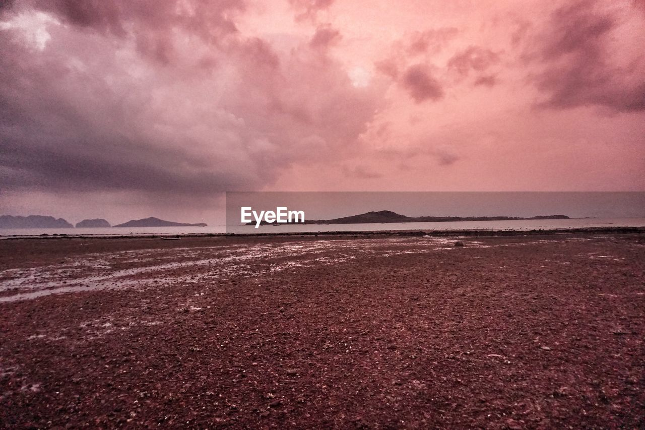 beauty in nature, scenics, tranquility, tranquil scene, nature, sky, outdoors, sea, no people, water, landscape, beach, sunset, day, mountain, salt - mineral