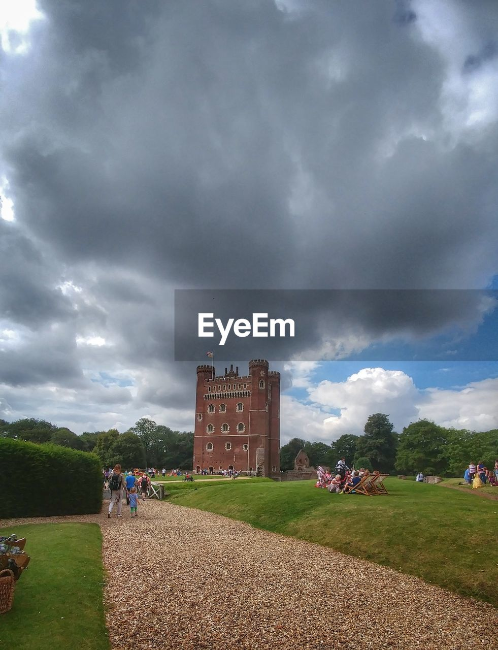 real people, cloud - sky, large group of people, sky, men, built structure, grass, leisure activity, architecture, lifestyles, women, field, nature, building exterior, day, outdoors, tree, people, adult