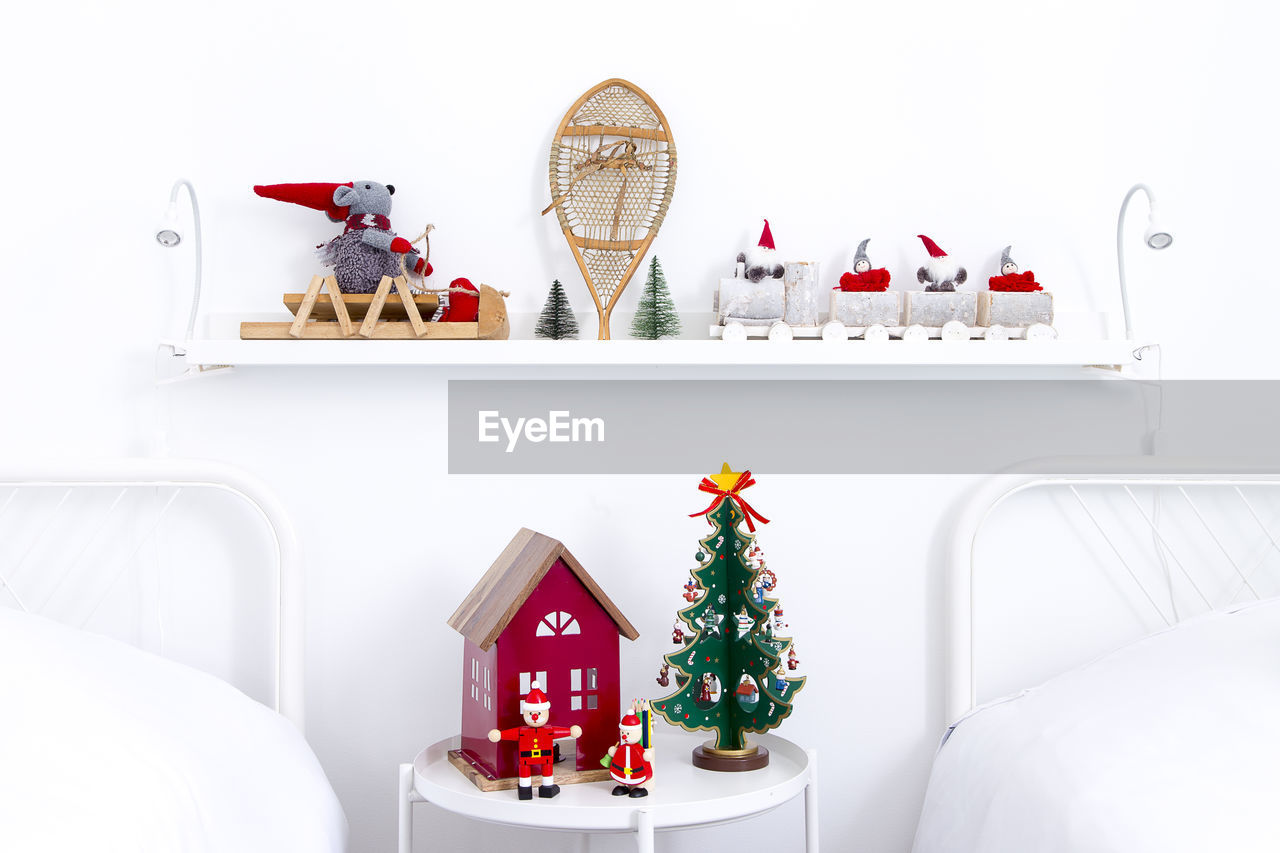 christmas decoration, decoration, indoors, christmas, no people, celebration, christmas tree, christmas ornament, holiday, representation, still life, table, holiday - event, art and craft, white color, shape, lighting equipment, animal representation, creativity, small