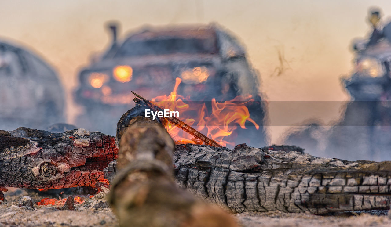 burning, heat - temperature, fire, fire - natural phenomenon, flame, nature, log, wood, smoke - physical structure, firewood, wood - material, orange color, glowing, selective focus, bonfire, motion, no people, burnt, outdoors, close-up, campfire