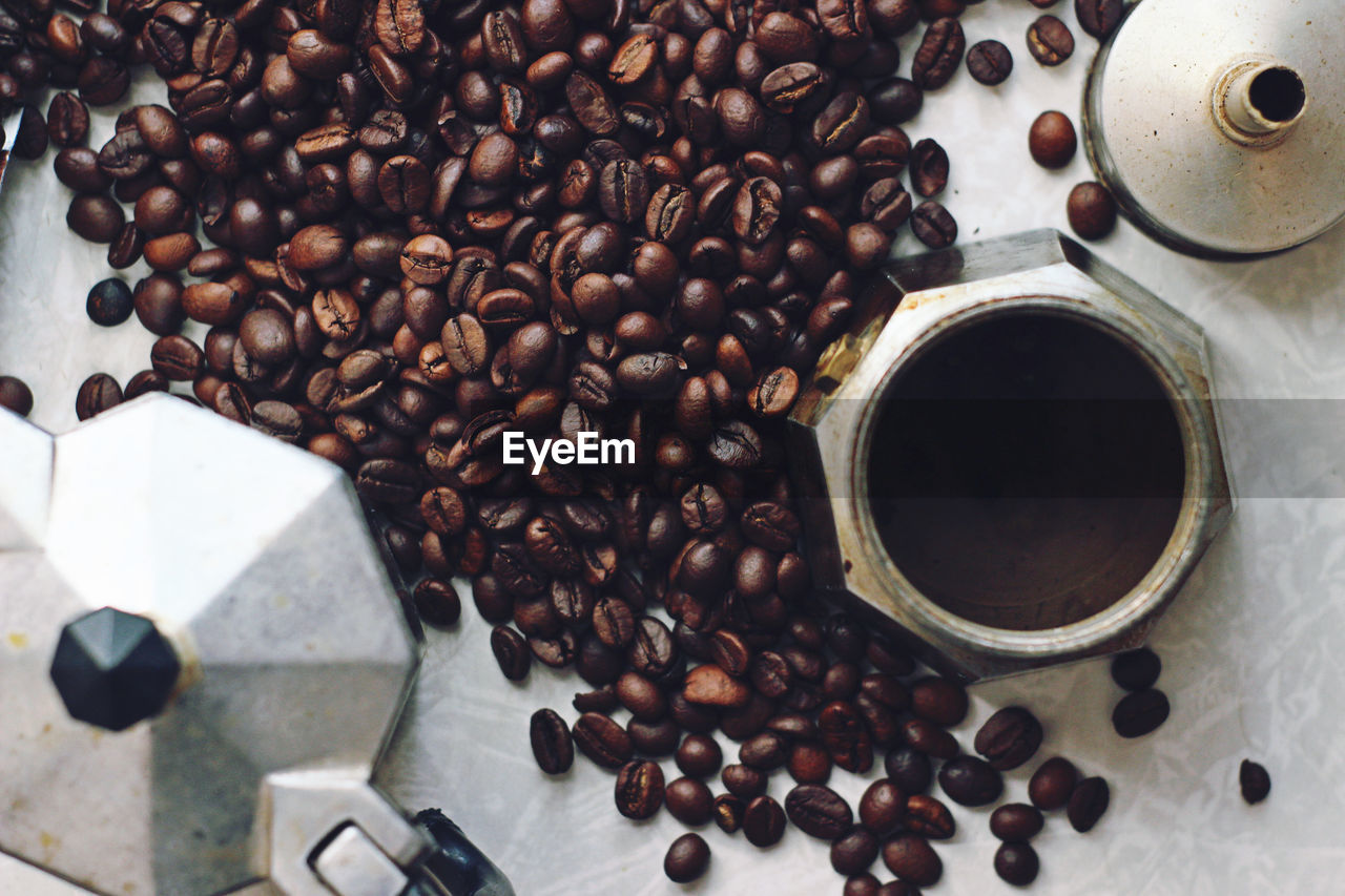 coffee, coffee - drink, food and drink, roasted coffee bean, drink, refreshment, food, cup, still life, high angle view, brown, abundance, large group of objects, coffee cup, indoors, coffee bean, freshness, no people, mug, directly above, caffeine, non-alcoholic beverage, crockery