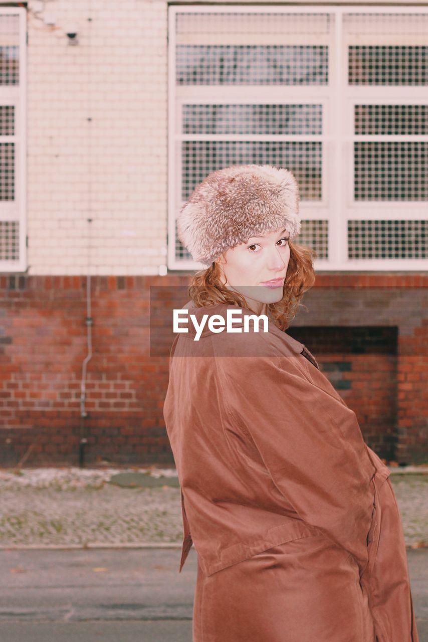 Woman  In Fur Hat Standing In City