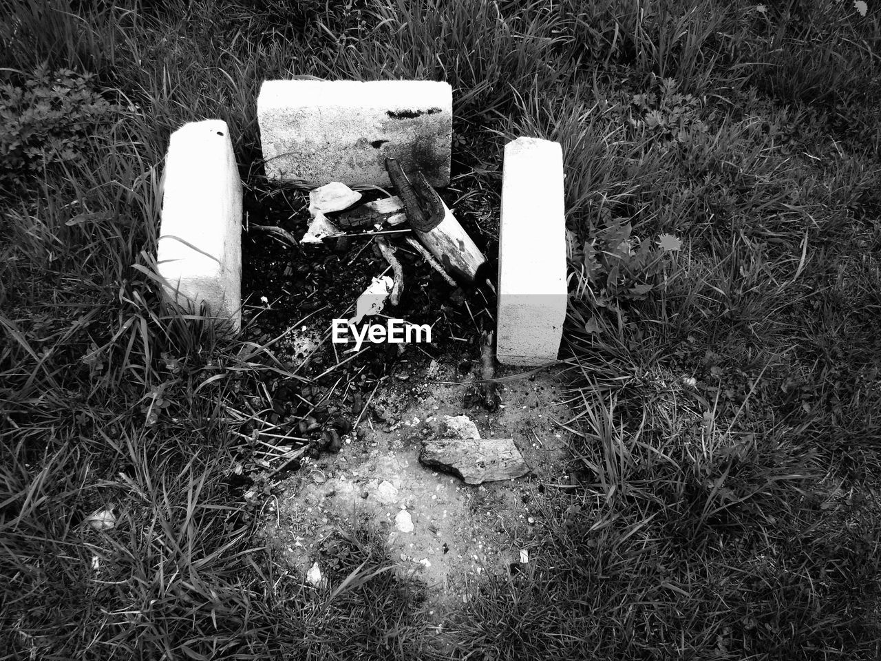 grass, land, no people, nature, field, plant, day, abandoned, high angle view, outdoors, grave, obsolete, cemetery, damaged, sadness, close-up, growth, environmental issues, religion, pollution
