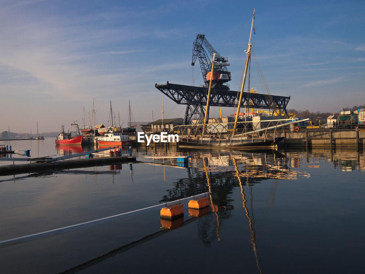 Crane At Harbor Against Sky