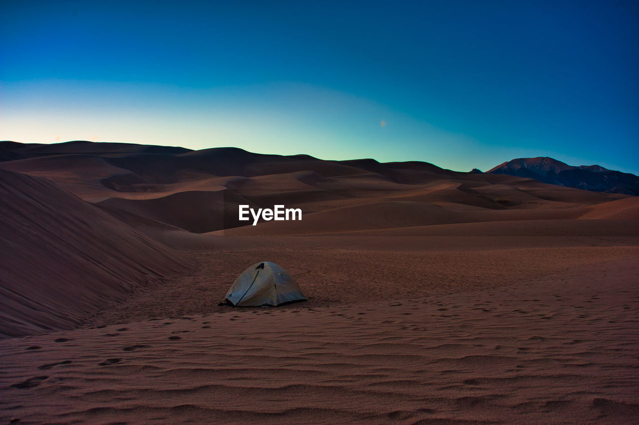 desert, scenics - nature, landscape, sand, land, sky, climate, arid climate, tranquil scene, beauty in nature, environment, sand dune, tranquility, non-urban scene, remote, mountain, nature, extreme terrain, idyllic, physical geography, no people, outdoors, atmospheric