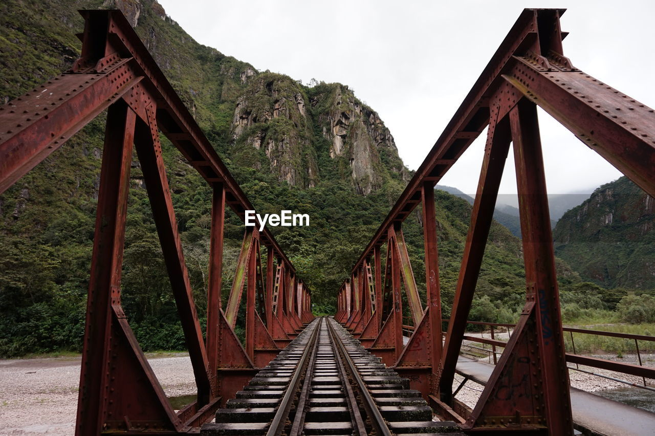 Railroad Track By Bridge Against Sky