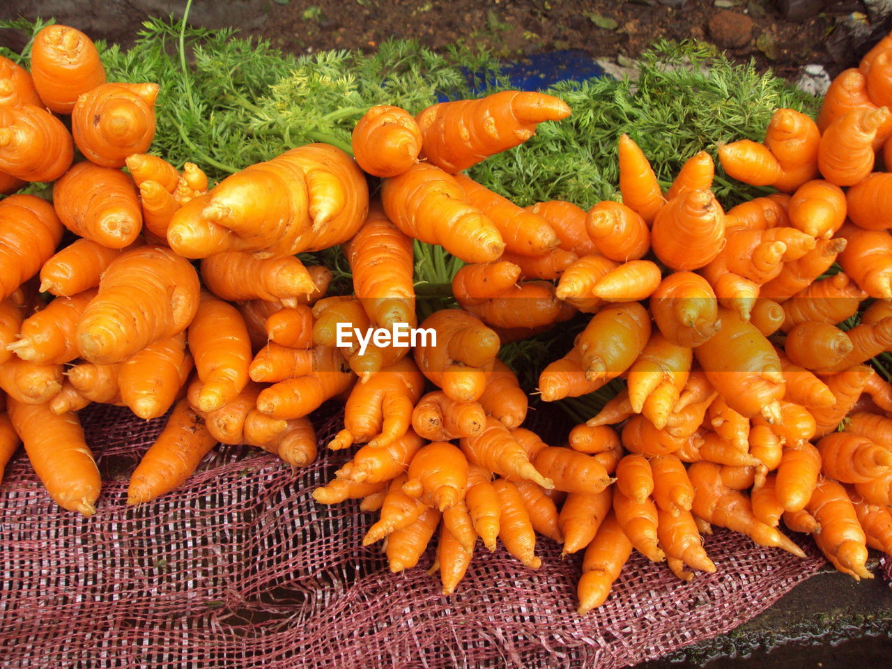 High Angle View Of Carrots For Sale In Market