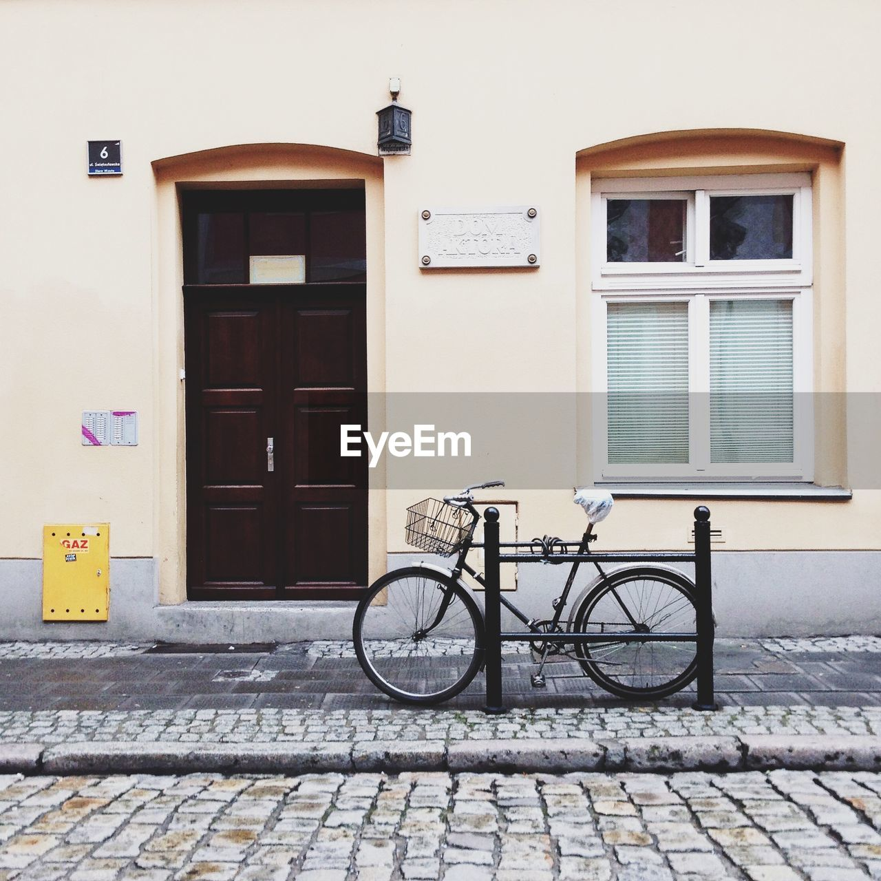 Bicycle Parked In Front Of House