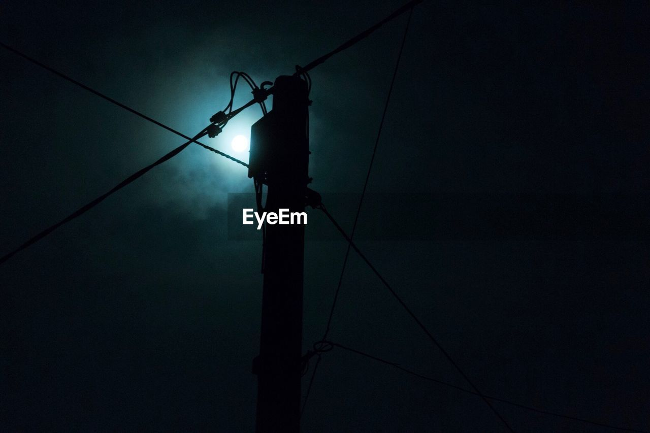 cable, electricity, power supply, power line, connection, fuel and power generation, technology, low angle view, lighting equipment, electricity pylon, night, silhouette, illuminated, no people, telephone line, outdoors